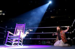 Photo of Bray Wyatt with a burning chair