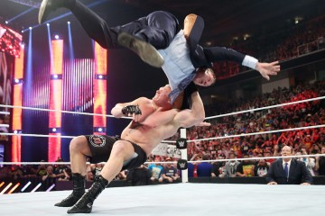 Photo of Brock Lesnar F5'ing Michael Cole