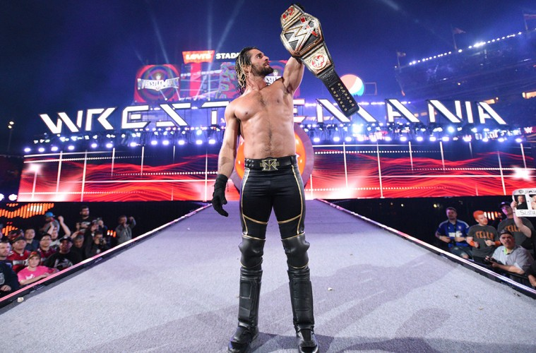 Photo of Seth Rollins with the WWE Title.