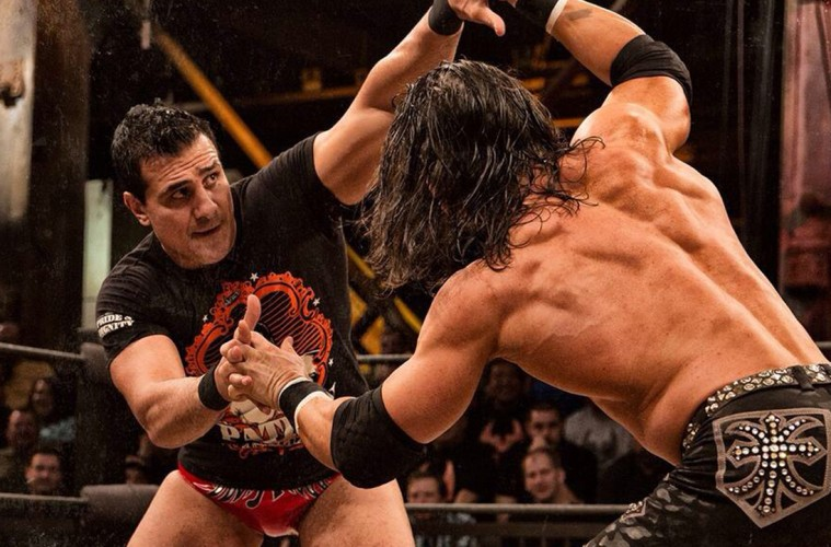 Photo of Alberto El Patron and Johnny Mundo wrestling.