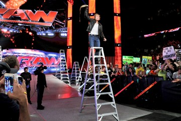 Photo of Dean Ambrose on a Ladder