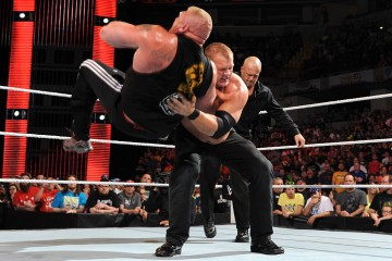 Photo of Kane chokeslamming Brock Lesnar