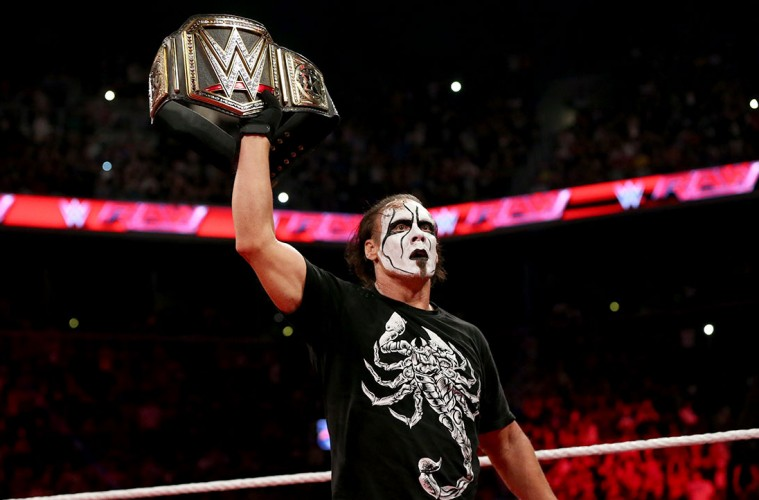Sting raises the WWE Title