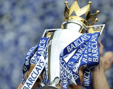 Close-up of Premier League Trophy being lifted.