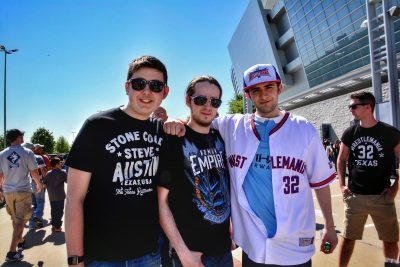 Aaron, Adam, and Mike pose outside the AT&T Stadium.